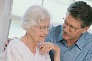 A family member serves as a caregiver for a patient with cancer.
