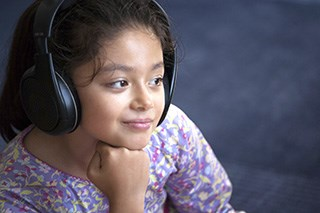 Audio therapy for pediatric postoperative pain
