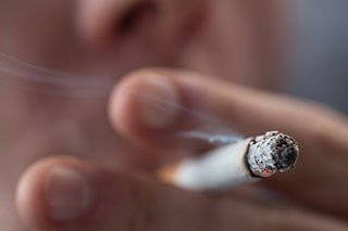Perception of risk from tobacco use is lower among cancer survivors who smoke
