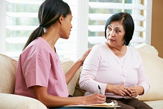 Home Visits From Promotora Increased Breast Cancer Screening Rates Among Latinas