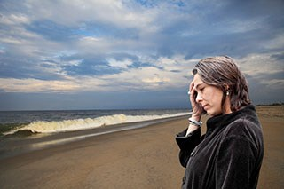 Case Study: A breast cancer survivor experiencing sex-related headaches after treatment.