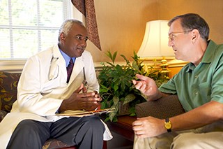 How many men actually speak to their doctor about prostate cancer symptoms?