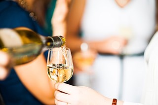Researchers have found a link between white wine consumption and skin lesion development.