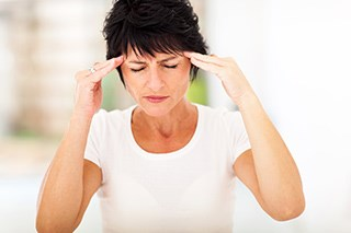 Menopause-related Nausea/Vomiting and Headaches Effects Tamoxifen Adherence