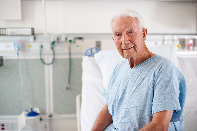 An older patient with cancer gets treatment at the ED.